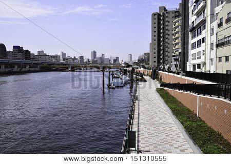 Kachidoki Bridge and Sumida River flowing through Tokyo Japan