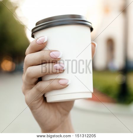 Hand Holding Cup Of Coffee On Morning