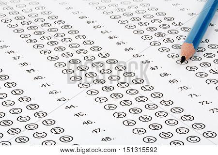 pencil on multiple choice answer sheet closeup