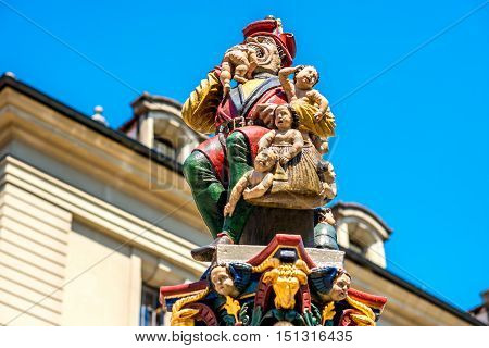 Bern, Switzerland - June 24, 2016: Child Eater fountain at the Granary place in Bern, Switzerland. It is one of the oldest Bern's fountains from the 16th century.