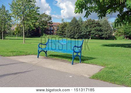 Park bench at Christchurch Meadows in Caversham, Berkshire.