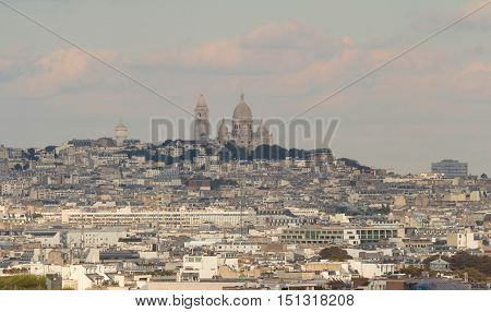 The Sacre Coeur basilica and parisian houses.The panoramic view from Eiffel tower Paris France.