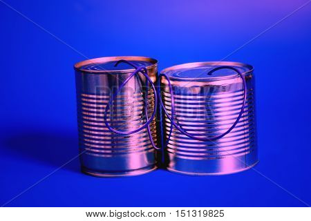 tin can phone on blue .communication concept.