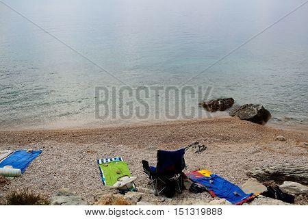 Beach Gear On Pebble Shore