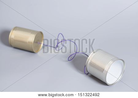 tin can phone on gray .communication concept