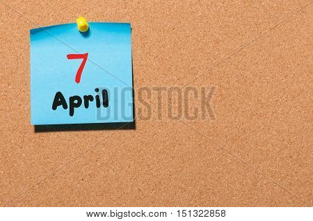 April 7th. Day 7 of month, calendar on cork notice board, business background. Spring time, empty space for text.