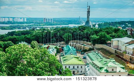 Kyiv cityscape from bell tower of Kyiv-Pechersk Lavra with view of Dnipro and Matherland Statue, Kyiv, Ukraine