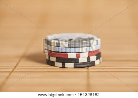 gambling chips on a wooden background .