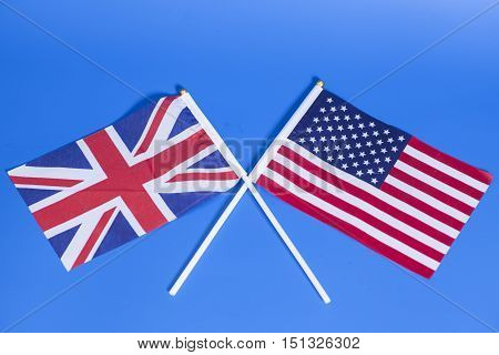 British (UK) and American (USA) flags on blue background