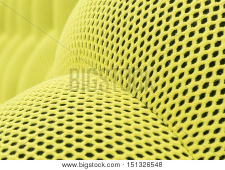 The colored yellow abstract background mesh checkered. Light green nylon texture designed as net streamline