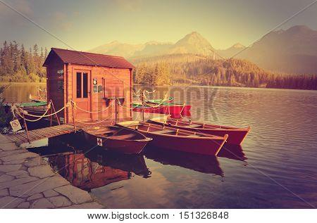 HIGH TATRA MOUNTAINS SLOVAKIA - SEPTEMBER 16 2016: Strbske Pleso Lake at sunrise in High Tatra Mountains Slovakia.