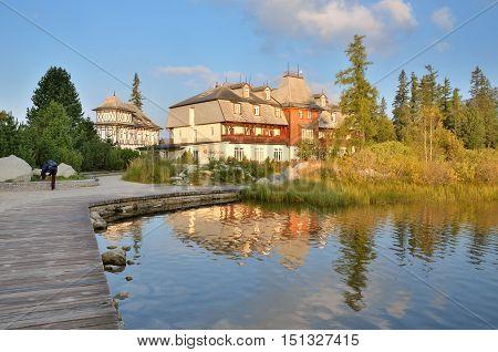 HIGH TATRA MOUNTAINS SLOVAKIA - SEPTEMBER 16 2016: Hotel over beautiful lake in High Tatra Mountains in Strbske Pleso Slovakia.