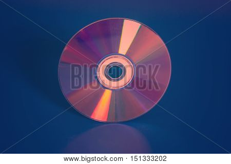 Compact shiny disk on a blue background