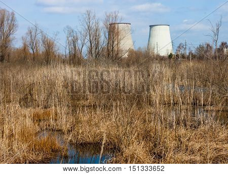 Two cooling towers of the cogeneration plant near Kyiv Ukraine. Industrial landscape.