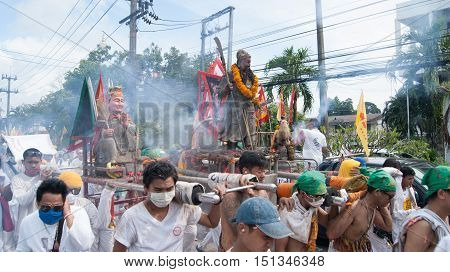PHUKET TOWN - OCT 7: A photo of people in parade, known locally as the Phuket Vegetarian Festival, on Oct 7, 2016 in Phuket Town, Thailand.