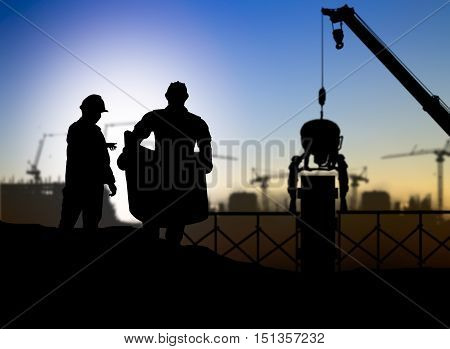 silhouette engineer looking at blueprints in a building site over Blurred construction worker on construction site