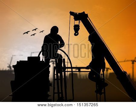 silhouette worker on construction site over Blurred construction site