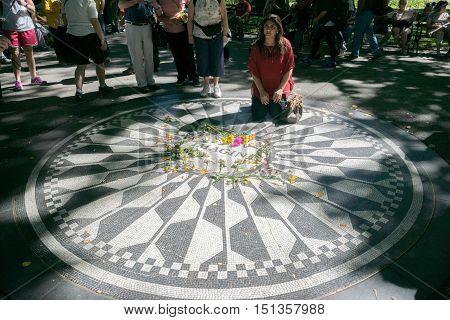 New York USA - September 20 2015: People visit the memorial place of John Lennon - Strawberry Field in Manhattan.