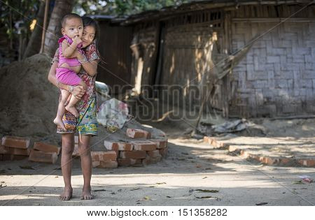 Chittagong Bangladesh February 25th 2016: bangladeshi girl holding her little brother