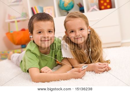 Little Boy And Girl Listening To Music Together