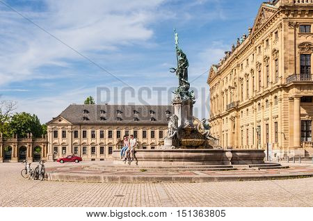 Wurzburg Germany - May 22 2016: Wurzburg Residence palace and statue Frankonia fountain in the foreground at Wurzburg Bavaria Germany. The Wurzburg Residence was inscribed in the UNESCO World Heritage List in 1981.