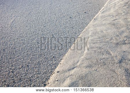 Gray sand surface with rich and various texture