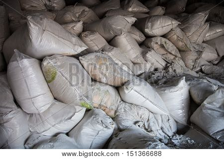 Pile of white sacks with synthetic fertilizer.