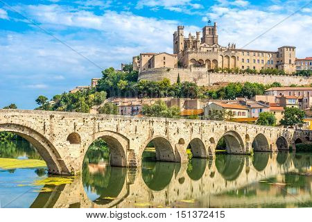 Panoramic view at the Old Bridge over Orb river with Cathedral of Saint Nazaire in Beziers