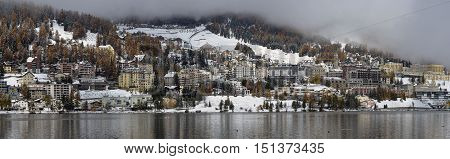 City on the Lake St. Moritz with the first snow in the autumn