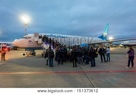 Moscow, Russia - October 5. 2016: Passengers boarding on the aircraft of low cost airline company Pobeda