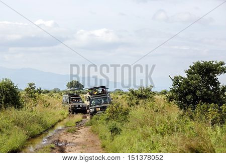 AFRICA, KENYA, MAY, 08, 2016 - Jeep-safari with people stuck on the washed out roads in Tarangire National Park, Tanzania.