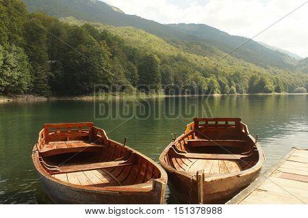 Pier and boats in Lake Biograd Biogradsko jezero Biogradska Gora national park Montenegro