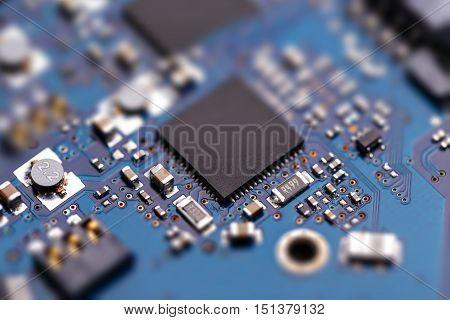Microprochip On Blue Circuit Board