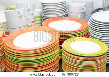 Crockery washing. Set of various clean dishware on table in kitchen