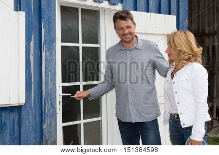 New Property Owners In Front Of Their House