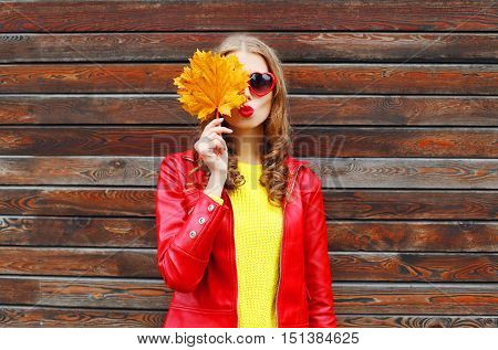 Portrait Pretty Young Woman With Autumn Yellow Maple Leafs Wearing A Red Leather Jacket Over Wooden