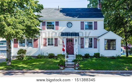 Canadian Home on White Siding House on Street