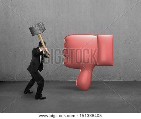 Businessman Holding Hammer Hitting Dislike Thumb Down