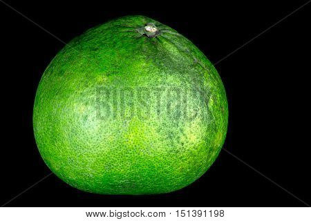 Pomelo fruit isolated against a black background