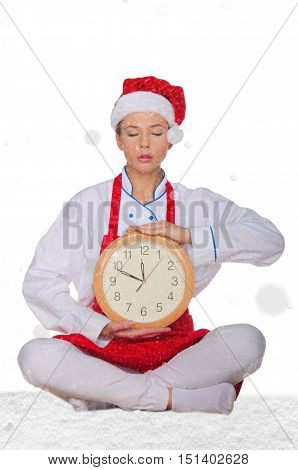 cook in Santa hat yoga clock under snow on white background