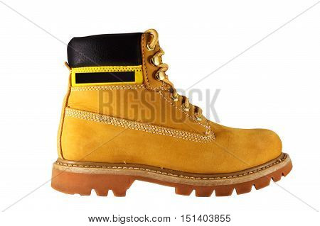 Large yellow shoes with rough soles and laces on a white background