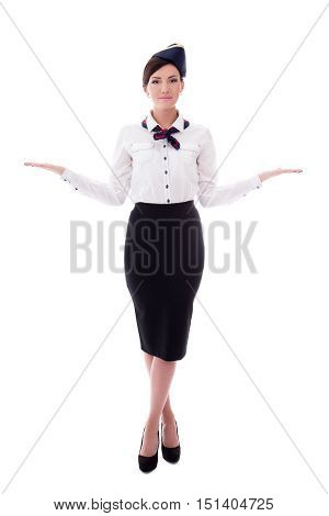 Young Smiling Stewardess Indicating Exits Isolated On White