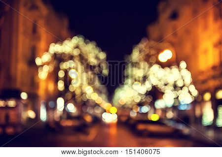 Christmas lights on the street at night. Blurred shiny background