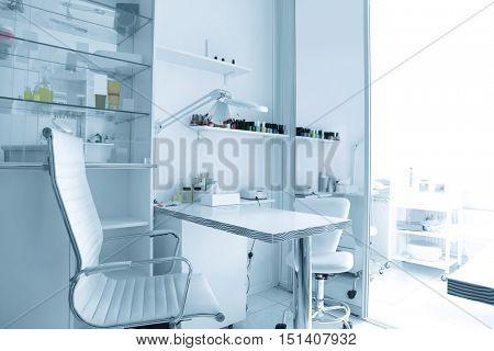 Manicurist work place in modern beauty salon