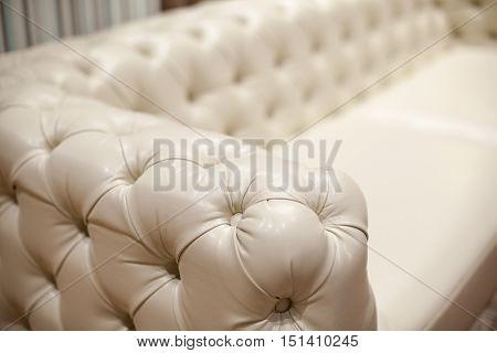 Ivory armrest of a luxury leather sofa