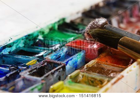 Artists Brushes And Watercolour Paints On Palette