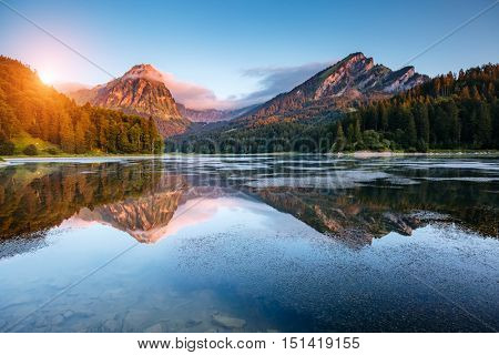 Majestic view of alpine pond Obersee at twilight. Popular tourist attraction. Picturesque and gorgeous scene. Location famous place Nafels, Mt. Brunnelistock, Swiss alps, Europe. Beauty world.
