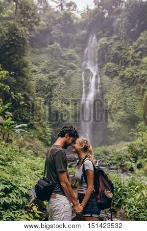 Affectionate Young Couple Standing Together In Forest