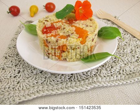 Millet turret with tomatoes, carrots and herbs