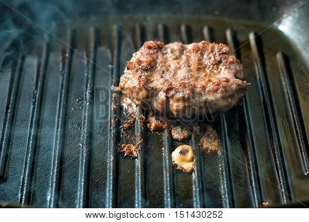 Beef Burger Patties Grilling On A Griddle Pan